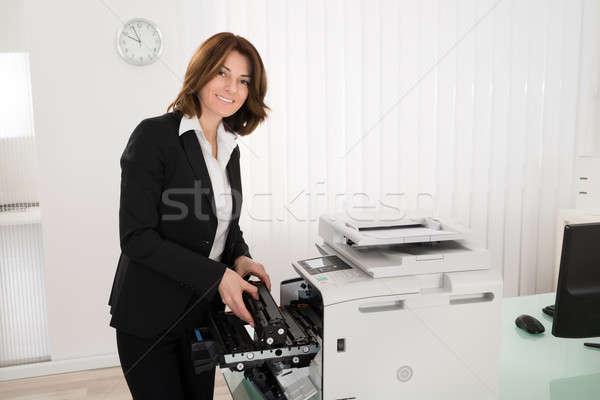 Businesswoman Fixing Copy Machine Stock photo © AndreyPopov