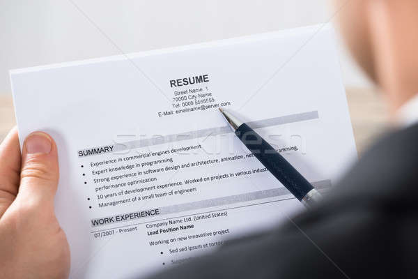Close-up Of A Businessman Analyzing Resume Stock photo © AndreyPopov
