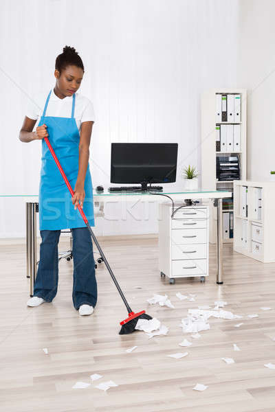 Female Janitor Sweeping Hardwood Floor Stock photo © AndreyPopov