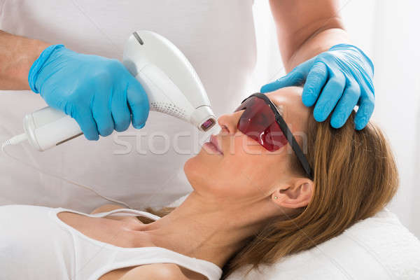 Nő fogad lézer epiláció szépség klinika Stock fotó © AndreyPopov