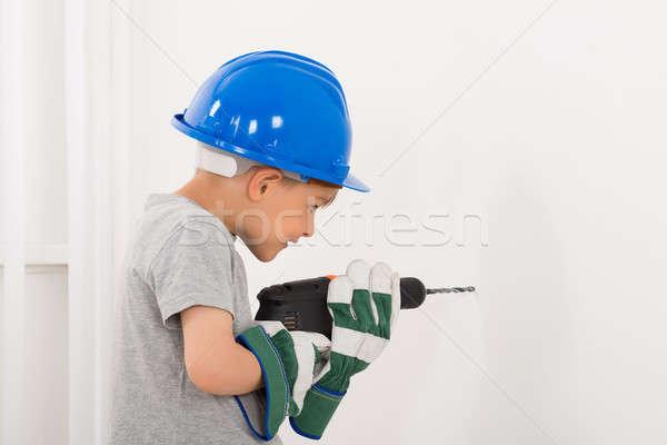 мало мальчика бурение стены электрических дрель Сток-фото © AndreyPopov