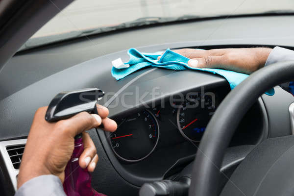 Close-up Of A Worker Wiping Dashboard Stock photo © AndreyPopov
