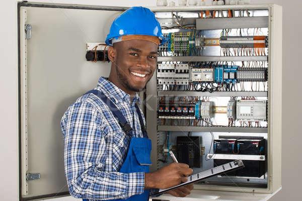 Male Technician Holding Clipboard Stock photo © AndreyPopov