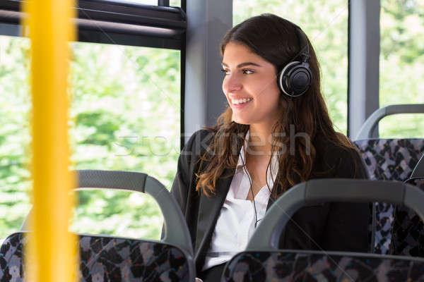 Businesswoman Listening Music Stock photo © AndreyPopov