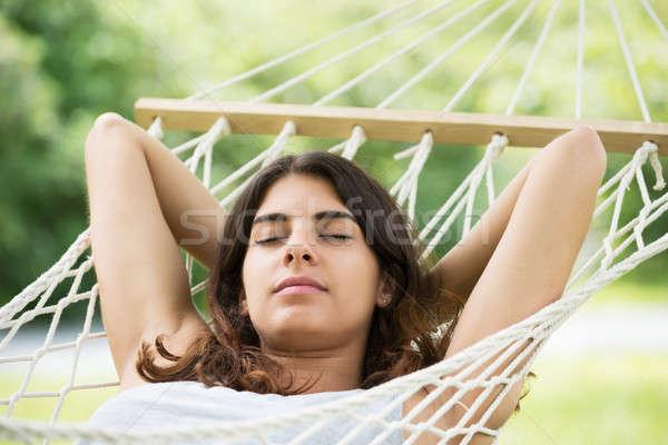Nő függőágy közelkép fiatal nő pihen élet Stock fotó © AndreyPopov