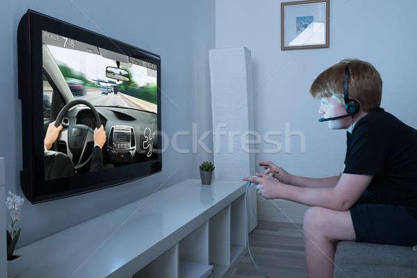 Erkek oynama araba oyun televizyon joystick Stok fotoğraf © AndreyPopov
