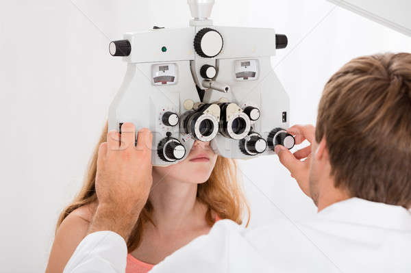 Optometrist Doing Sight Testing For Girl Stock photo © AndreyPopov