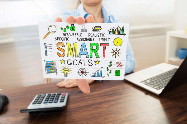 Businesswoman Holding Paper Showing Smart Goals Concept Stock photo © AndreyPopov