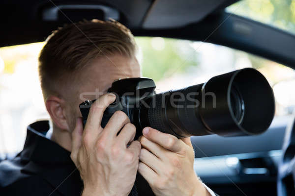 Man Photographing With SLR Camera Stock photo © AndreyPopov