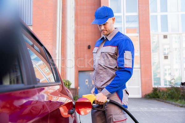 Férfi megtankol autók tank tart benzin Stock fotó © AndreyPopov