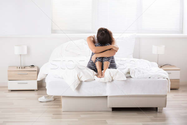 Contemplated Woman Sitting On Bed Stock photo © AndreyPopov