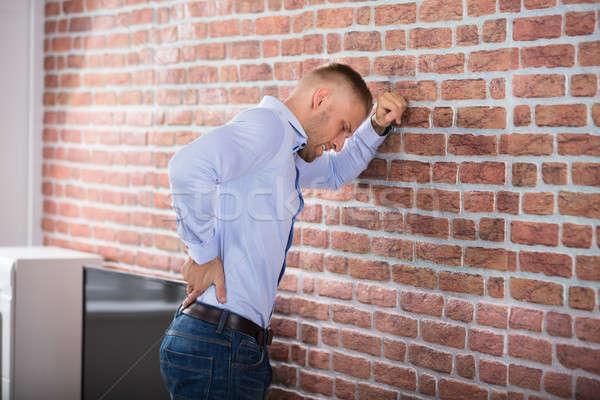 男 触れる 若い男 壁 ストックフォト © AndreyPopov