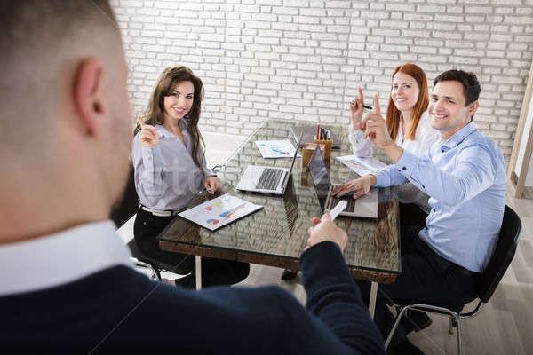 Işadamı soru toplantı arkadaşları tanıtım Stok fotoğraf © AndreyPopov