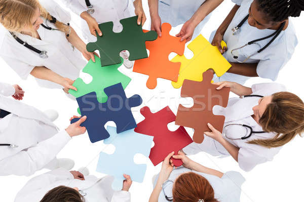 Medical Team Solving Jigsaw Puzzle Stock photo © AndreyPopov