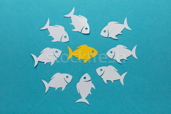 Yellow Fish Surrounded By White Paper Fishes Stock photo © AndreyPopov