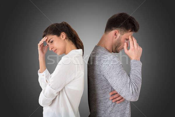 Frustrado casal em pé de volta jovem cinza Foto stock © AndreyPopov