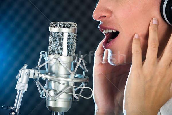 Kadın açmak ağız kırmızı ruj mikrofon Stok fotoğraf © AndreyPopov