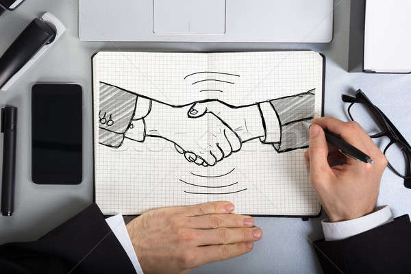 Business Person Drawing Handshake Concept Stock photo © AndreyPopov