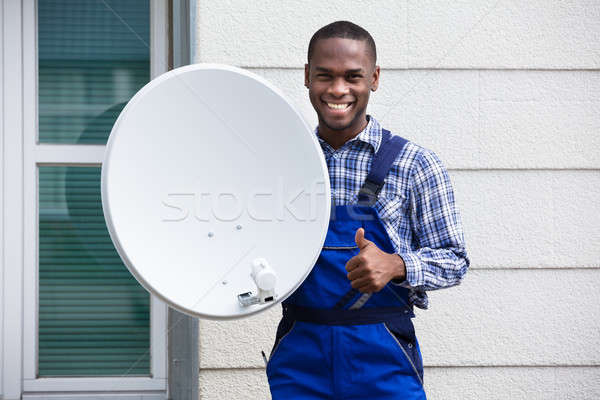 Happy Male Technician With TV Satellite Dish Stock photo © AndreyPopov