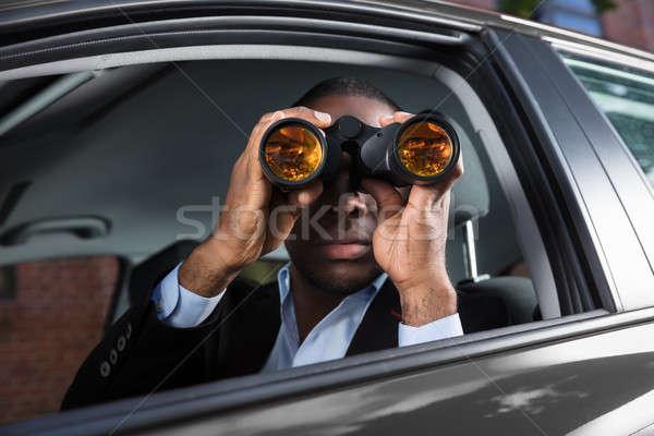 African Man Looking Through Binocular Stock photo © AndreyPopov