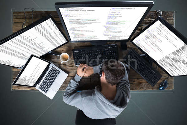 Elevated View Of Man Sleeping On Desk Stock photo © AndreyPopov