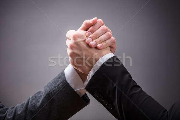 Twee arm worstelen grijs Stockfoto © AndreyPopov