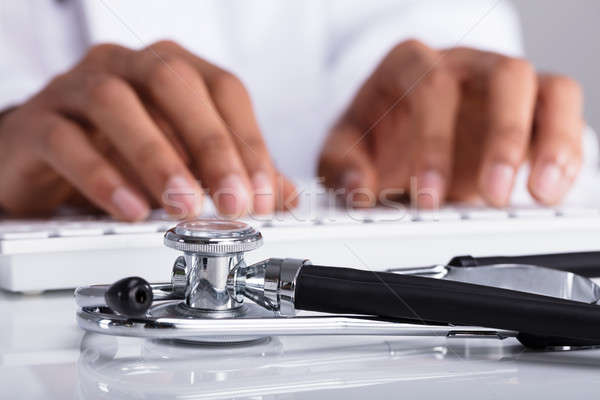 Doctor Typing On Computer Keyboard Stock photo © AndreyPopov