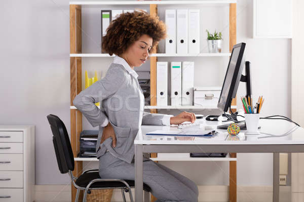 Businesswoman Suffering From Back Pain Stock photo © AndreyPopov