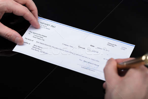Businessperson Signing Cheque Stock photo © AndreyPopov