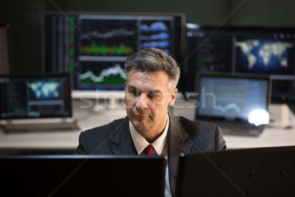 Stock Market Broker Looking At Multiple Computer Screen Stock photo © AndreyPopov