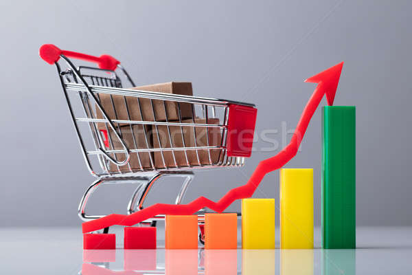 Business Graph With Red Arrow Sign Showing Upward Direction Stock photo © AndreyPopov