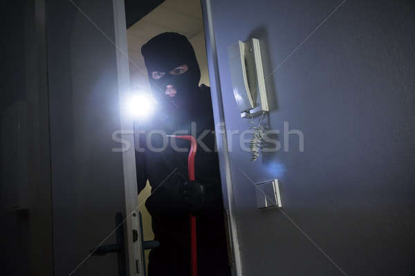 Thief Entering Into House Stock photo © AndreyPopov