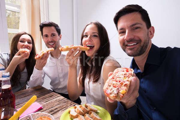 Barátok eszik finom bruschetta portré boldog Stock fotó © AndreyPopov
