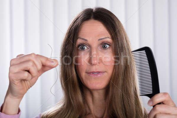 Shocked Woman Losing Hair Stock photo © AndreyPopov