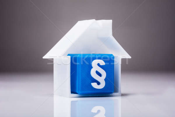 Blue Cubic Block With Paragraph Symbol Inside House Model Stock photo © AndreyPopov