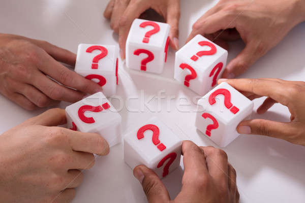 Businesspeople Holding Cubic Blocks With Question Mark Sign Stock photo © AndreyPopov