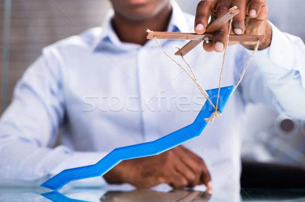 Man's Hand Holding Arrow Puppet Stock photo © AndreyPopov