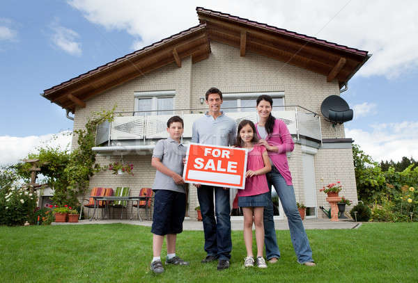 Family selling their home holding for sale sign Stock photo © AndreyPopov