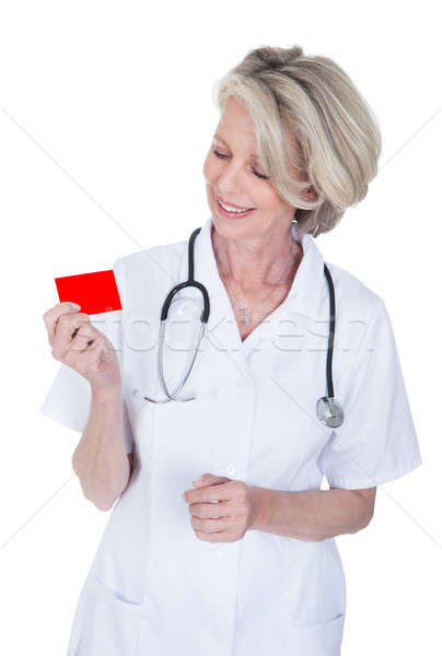 Mature Female Doctor Holding Visiting Card Stock photo © AndreyPopov