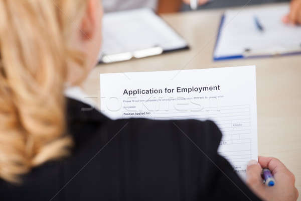 Businesswoman Holding Application Form Stock photo © AndreyPopov