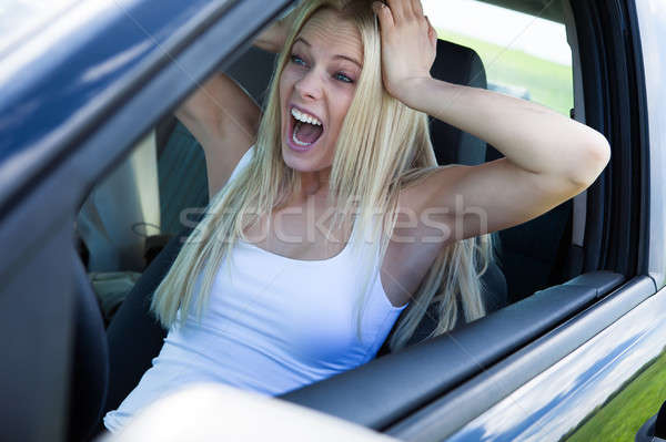 Blonde Woman Sitting In Car And Screaming Stock photo © AndreyPopov