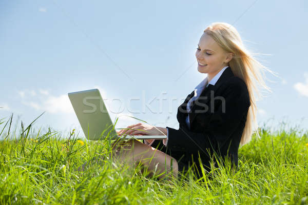 Businesswoman Using Laptop Stock photo © AndreyPopov