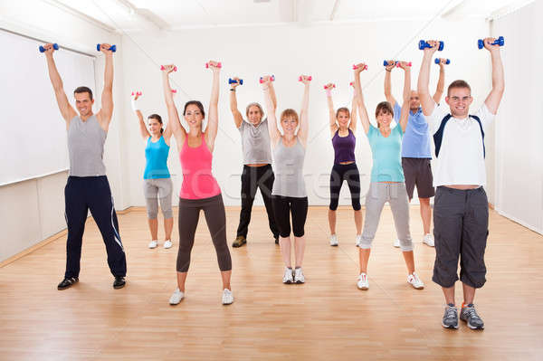 Aerobics class working out with dumbbells Stock photo © AndreyPopov