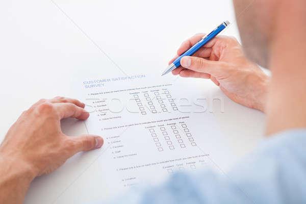 Personne remplissage forme enquête stylo Photo stock © AndreyPopov