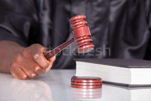 Hand Striking Gavel In A Courtroom Stock photo © AndreyPopov