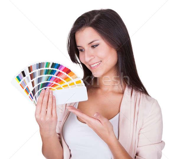 Attractive woman chooses a color scheme Stock photo © AndreyPopov