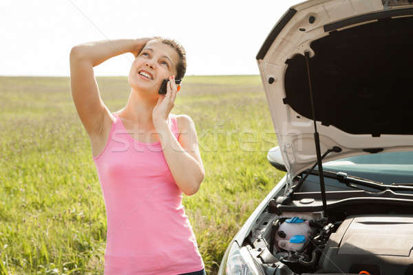 Woman Calling On Mobilephone For Road Service Stock photo © AndreyPopov