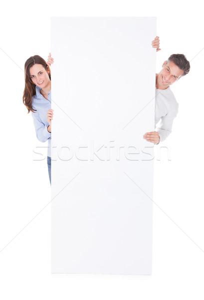 Uomo donna cartellone bianco sfondo Foto d'archivio © AndreyPopov