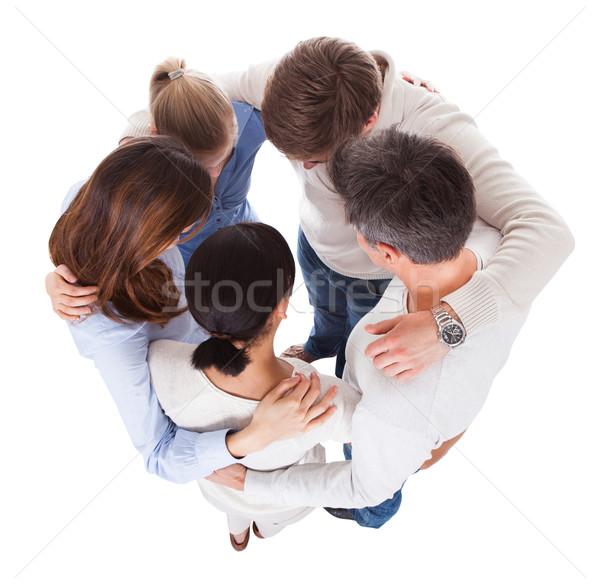 Grupo de personas mirando hacia abajo grupo diverso personas blanco Foto stock © AndreyPopov