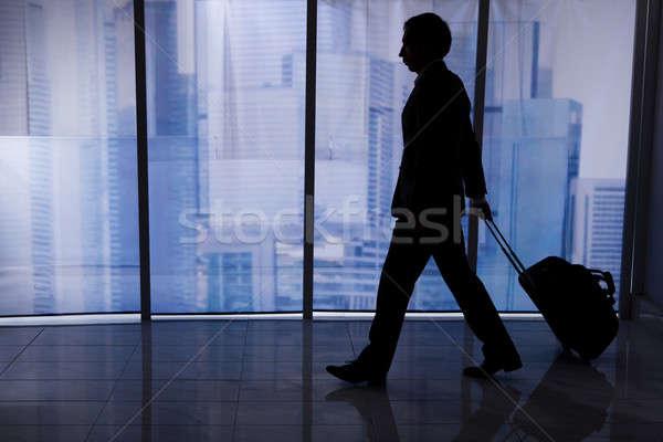 Imprenditore piedi bagaglio ufficio vista laterale Foto d'archivio © AndreyPopov